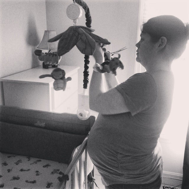 Mary getting Henry's nursery together about a month before he was born.