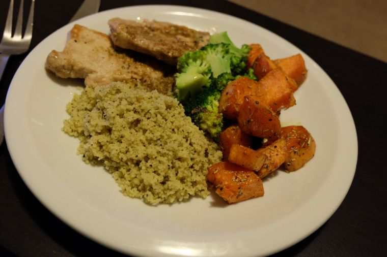 Sage butter fried pork tenderloin, broccoli, and sweet potato with mint parsley couscous