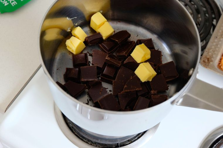 Melt butter and chocolate in a heat proof bowl over simmering water. Or, a double boiler. I don't have a heat proof bowl, so I improvised.