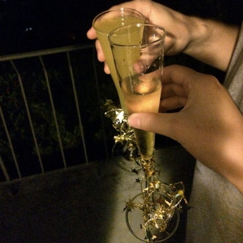 "Ringing in 2015 with champagne and a 6"" Huntsman spider crawling above us."