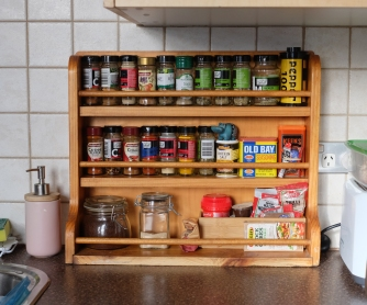 I was obsessing over spice racks, so our friend Hugh gave us one of his. Hooray! No more clunky spice drawer for us. Next step - new spice jars.