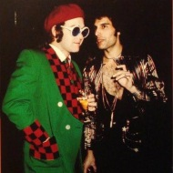 my flu-addled brain was obsessed with two things: running a fever, and researching and image searching Queen. Here's Freddie Mercury with Elton John #productive